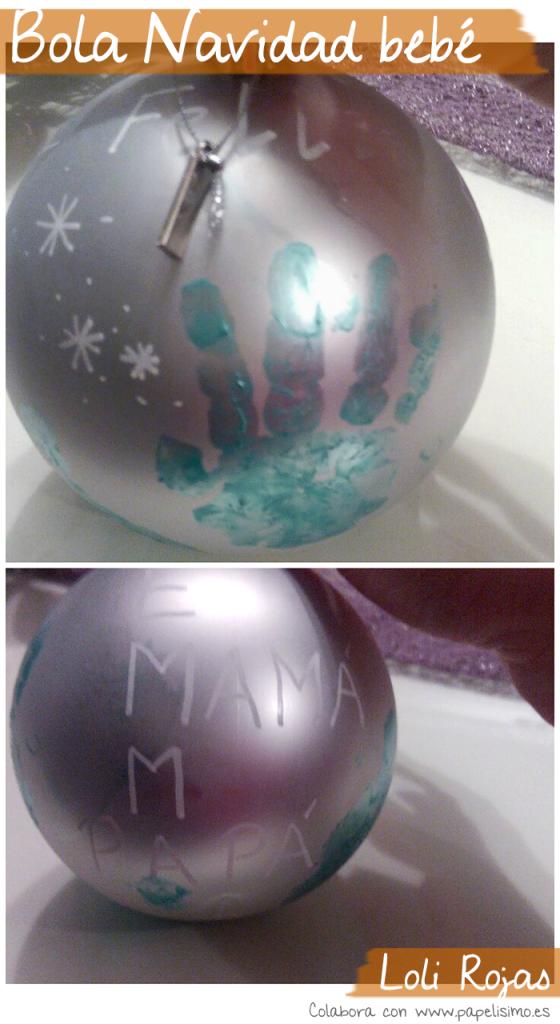 bola de navidad con mano de bebé